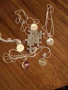 Personalized Puzzle Piece Hand Stamped Family Necklace. $12.00, via Etsy.