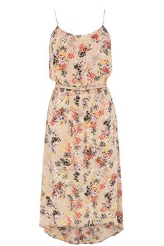 This gorgeous cami-style midi dress features an oriental inspired floral print across the fabric and a dip hem finish. The piece has adjustable shoe string straps and a gathered waist with skinny belt.