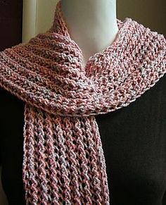 This easy faggot stitch scarf is quick to knit and in Cotton Twirl makes an all season scarf.