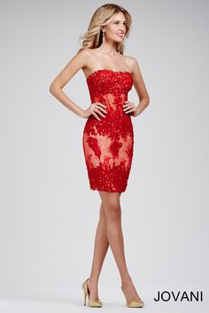 This #jovani 32712 red corset dress with lace detail is sure to steal the show.