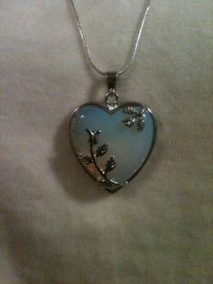 Whats better than hearts and roses?   This pendent is 1 5/8 long and 1 1/4 wide. Sold on a 20 inch silver chain.