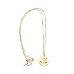 "Simple but Elegant Beach Days Necklace is an 18k Gold on Bronze Charm of a Sand Dollar. It is on a Gold-Filled Oval Loop Chain with a Gold-Fill Toggle. 17"" in length. Great for Layering with Other Necklaces. Product #14-061"