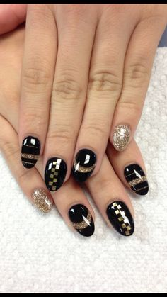 Gold and black gel nails, checker and stripe designs