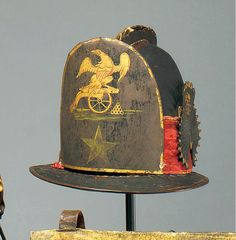 A LEATHER ARTILLERY HELMET, PROBABLY CONNECTICUT, WAR OF 1812