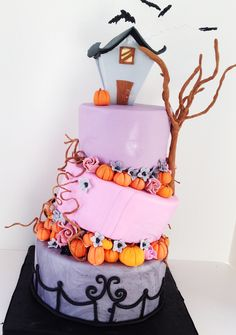 Spooky Topsy Turvy - This topsy turvy cake was created using the tutorial by Sharon Z from SugarEd Productions. This method uses wedges. This was created for a young lady who loves having a spooky birthday celebration