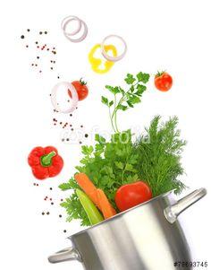 """Téléchargez la photo libre de droits """"Cooking pot with fresh vegetable ingredients isolated on white"""" créée par viperagp au meilleur prix sur Fotolia.com. Parcourez notre banque d'images en ligne et trouvez l'image parfaite pour vos projets marketing !"""