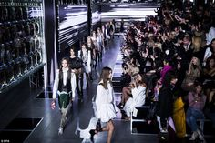 The walls of the show were mounted with digital screens which flickered as the models took...