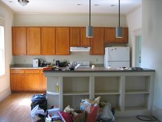 View of kitchen from living room-- beautiful built-in shelves under counter by kathrynrsthompson, via Flickr