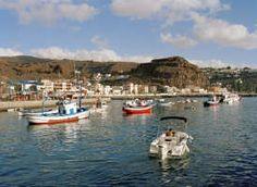 Canary Islands, La Gomera, boats moored in small cove