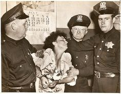 Chicago police arresting a mother, Mrs. Lucille Grider, accused of slaying her 7 year old daughter. (1946)