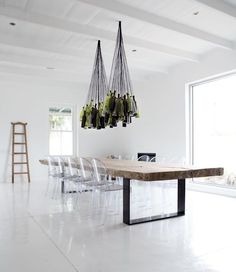 Great table and Repurposed Wine bottle chandelier - Maison Estate in New Zealand