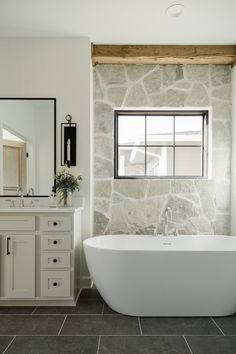modern traditional bathroom with pebble wall and freestanding tub What is Decoration? Decoration could be the … Bathroom Renos, White Bathroom, Modern Bathroom, Neutral Bathroom Interior, Bathroom With Wood Wall, Dark Floor Bathroom, Neutral Bathroom Tile, Back To Wall Bath, Rustic Master Bathroom