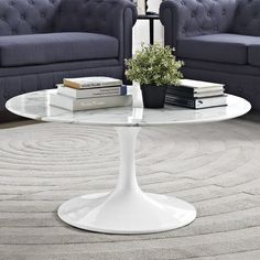 Reflecting a seamless organic shape and timeless form, this Coffee Table has become a symbol of modernism for over the past 60 years. Before its release, homes were filled with clunky remnants of an industrial age long gone by. But in order to advance into the new world, homes first had to transition from the traditional square table, into a piece that connoted progress. The base and dimensions are true to the original specifications, while the table's circular top, and tapered base, are…