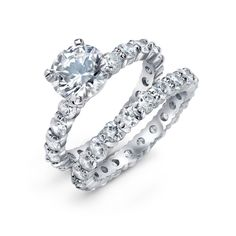 Measure: Rings combined width measures .1875in   Weight: 4 grams.  Material: .925 Sterling Silver Cubic Zirconia