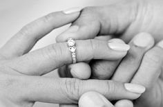 Take our engagement ring poll. Woman Wearing Engagement Ring by Surachai