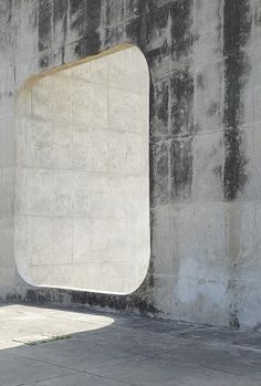 Le Corbusier - Chandigarh. Concrete. Opening that requires a step-through.