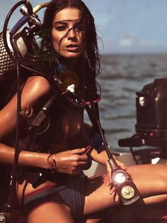 This picture bugs me cause as a woman who scuba dives she's not wearing a wetsuit or even a rash guard and you can't dive with your hair down cause it floats in front of our face!