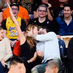 Star Tracks: Monday, November 24, 2014 | KISS CAM | Maroon 5 rocker Adam Levine plants one on his wife, model Behati Prinsloo, at the Denver Nuggets vs. L.A. Lakers basketball game on Sunday at the Staples Center.