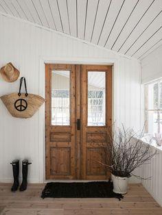 Beadboard, wood French doors, hunters and twigs= love! Anna Truelsen interior stylist