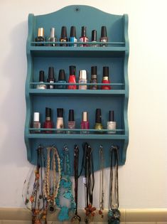 super easy upcycled spice rack- just repainted it and added cheap silver screw in hooks. viola!