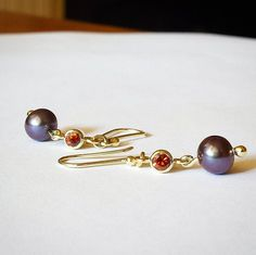 Another pair of richly toned earrings featuring Purple Fresh Water Pearls and locally found Oberon ' Port-Wine ' Zircons set in 14K Yellow Gold.  Available from the Bathurst Regional Art Gallery   #bathurstnsw #regionalnsw #foxartisticcreations #jeweller #goldsmith #handmade #handcrafted #unique #progresspic #wip #zircon #earrings #pearlearrings #cognaczircon #australianzircon  #freshwaterpearl  #14kgold #yellowgold #ethicalgems #local #purplepearls #redzircon #oberon