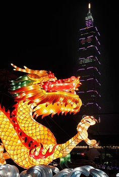 A dragon-shaped lantern in front of Taiwan's landmark building Taipei 101