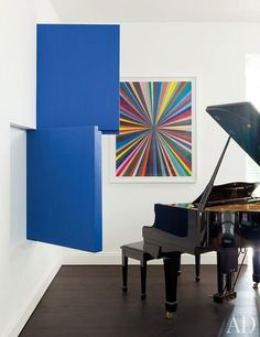 A Yamaha grand piano shares a corner with contemporary works by Therrien and Mark Grotjahn | archdigest.com