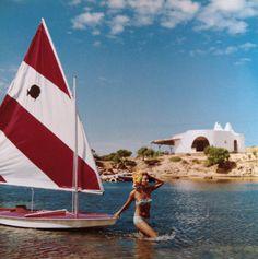 By Slim Aaron, LA DOLCE VITA (Bettina Graziani 1964 in Sardinia near her modernist white villa)