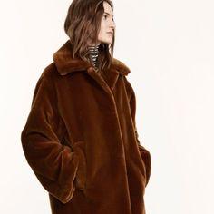 This brown teddy bear coat is made of fake fur and it has a loose fit. | Helga coat. | #marimekko