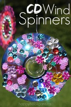 Vibrant CD Wind Spinners Ornament! SO easy to make, and they spin like crazy!  Great for the patio, porch, deck or balcony.  You could even hang them from the branches of a tree.  They'd make a beautiful window ornament or Christmas ornament too! - Happy Hooligans