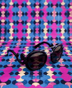 Bold prints are in. Embrace your inner fashion model with sophisticated frames from Prada.