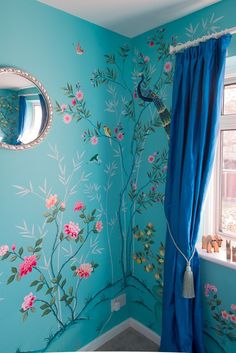 Diane Hill hand painted interiors turquoise chinoiserie mural. Colourful nursery (or children's bedroom) inspired by 18th century silk wallpaper. Create a stunning interior design for your #home #decor, or a feature wall.   This corner of the nursery interior features chinoiserie peonies and a beautiful chinoiserie peacock nestled in a tree.