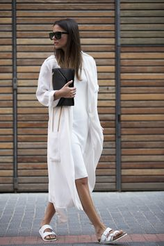 White on white with a black bag, black sunnies and white Birkenstocks- minimal and classic