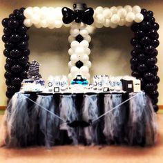 Tuxedo balloon arch for a mustache, bow baby shower