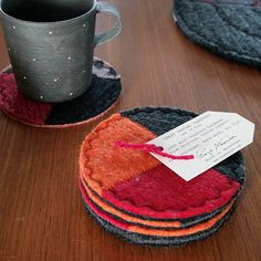 Coasters made from old wool sweaters - pic for inspiration ***like the decorative stitches !!!