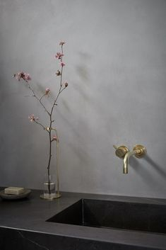 Beautiful pictures from the new Menu bath campaign. I like the combination of the grey natural stone with the brass taps, the matt black bathroom products and the delicate pink flower. Menu Bathroom story - via Coco Lapine Design Bathroom Inspiration, Interior Inspiration, Interior Styling, Interior Decorating, Spa Like Bathroom, Bathroom Sinks, Small Bathrooms, Sink Faucets, Beautiful Bathrooms