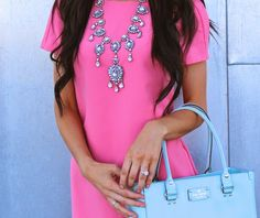 bright pink with great statement necklace and  baby blue kate spade.