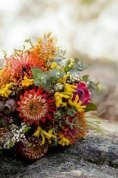 """Australia Natives"" Wedding Bouquet: Yellow Kangaroo Paw, Red-Orange Pin Cushion Protea, Marsala Queen Protea, Gum Nuts, Additional Coordinating Florals & Foliage"