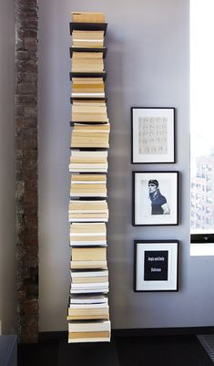 Michael Cunningham wall bookself with books placed backwards