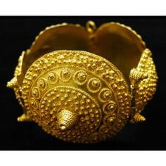 Maker: Wolof peoples Bracelet  (Tambourin) Medium: Gold alloy Dimensions: H x W x D: 9.1 x 8.7 x 6 cm (3 9/16 x 3 7/16 x 2 3/8 in.) Credit Line: Gift of Dr. Marian Ashby Johnson Geography: Senegal