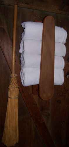 Sheepscot River Primitives - Old sleeve ironing board re purposed for a useful towel holder.
