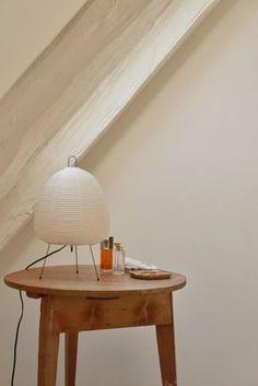 Noguchi lamp on side table in Copenhagen apartment. Bedside Table Lamps, Bedroom Lamps, Lamp Table, Isamu Noguchi, Copenhagen Apartment, Round Wood Table, Skandinavisch Modern, Copenhagen Design, Snuggles