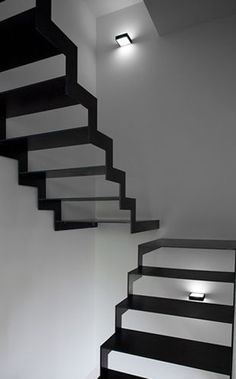 Inspired by the airiness of the staircase and the colour scheme. Black Stairs in In Piacenza Architecture Design, Stairs Architecture, Interior Staircase, Staircase Design, Staircase Remodel, Stair Design, Staircase Ideas, Black Stairs, Escalier Design