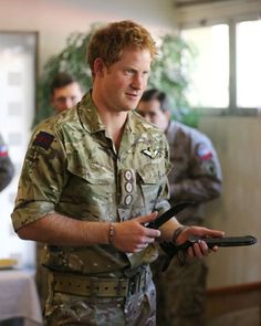 Prince Harry is presented with a ceremonial knife after he met members of the Chilean Special Operations Brigade at Peldehue outside Santiagom 27.06.2014 in Santiago, Chile.