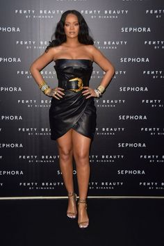 Rihanna wears a black Versace leather dress and belt at Fenty Beauty event in Milan, Italy. Photo: Splashnews