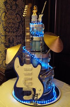 Amazing guitar and drum set tiered cake.