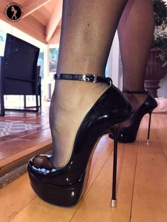 Super high stilettos with a sexy ankle strap on these classic black sky high platform pumps Extreme High Heels, Very High Heels, Platform High Heels, Black High Heels, High Heels Stilettos, High Heel Boots, Stiletto Heels, Sexy Heels, High Sandals