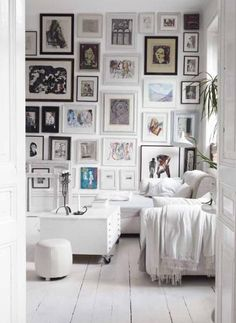 love this white room, with a picture wall - fun reading family room :)