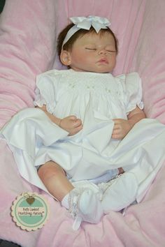 "ELVA BROOKE is a custom ordered baby made from Marissa May's ""Meg"" sculpt. She is 20"" long, weighs 4 lbs., 10 oz., and has beautiful hand rooted medium light brown Delta Dawn mohair. TASMANIA, AUSTRALIA with her cousins, Kemeka and Chantalle. See her at www.heartstringsnursery.com"