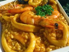 Arroz caldoso de calamares cocina tradicional